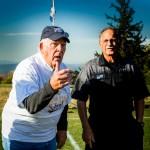 Daniel Loh '52, flips the coin at the SKS girls varsity soccer game Wednesday, October 12th