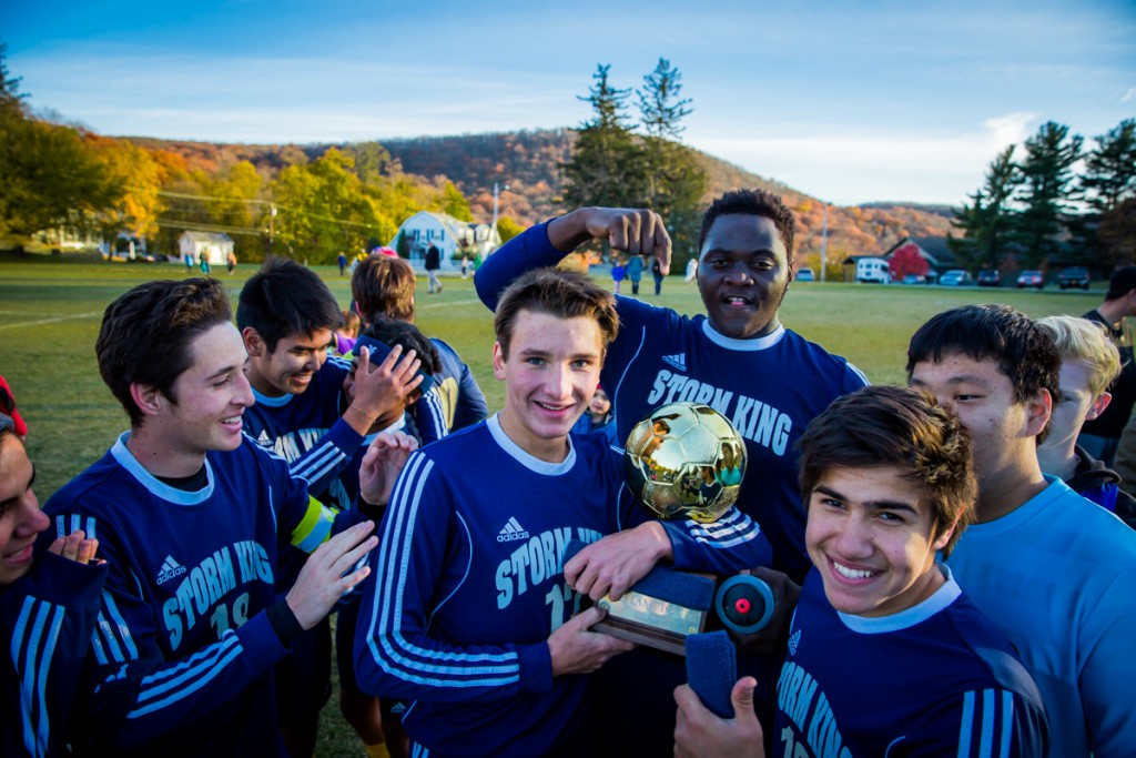 SKS boys varsity soccer enjoying their HVAL trophy win